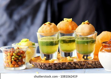 Pani Puri shots, Indian street snack made of fried puries, mint chutney, sprouts and boiled potatoes. Indian Chat