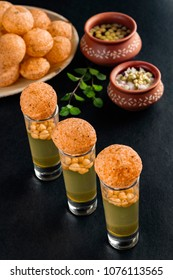 Pani Puri shots, a north Indian street snack made of fried puries and mint water which is all time favourite.