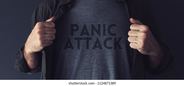 Panic attack concept, guy stretching shirt to reveal the title imprint on his chest