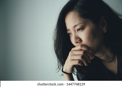 panic attacks alone young girl sad fear stressful depressed emotional.crying use hand cover face begging help.stop abusing domestic violence in women,person with health anxiety,people bad feeling down