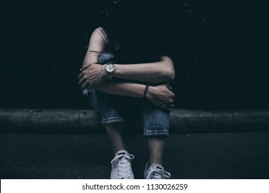 panic attacks young girl in sad and fear stressful depressed emotional.sitting and cry hug knee begging for help.concept for stop abusing violence in women,human rights,person with anxiety.dark tone.