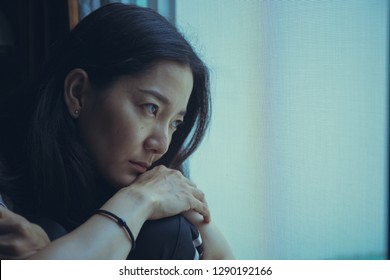 panic attacks young girl sad and fear stressful depressed emotional.crying use hands cover face begging help.stop abusing domestic violence in women,person with health anxiety,people bad feeling down