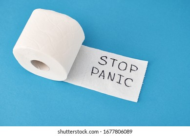 Panic buying Covid-19 Coronavirus outbreak concept. Roll of toilet paper with inscription stop panic and surgical mask on blue background.