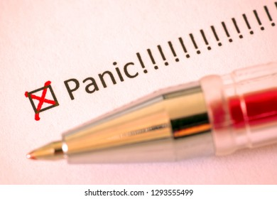 Panic - checkbox with a cross on white paper with pen. Checklist concept.