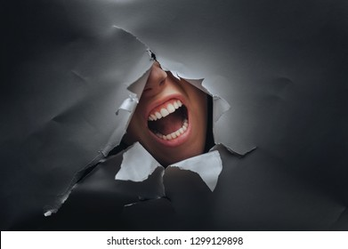 Panic on the woman's face. Anger and despair. The concept of torment, cry, pain and scream.