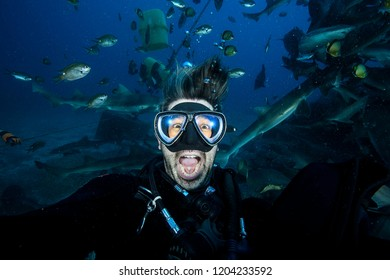 Panicking and Scared Scuba Diver with Mouth Wide Open Underwater