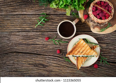 Panini sandwich with cheese and mustard leaves. Morning coffee. Village breakfast. Top view. Flat lay