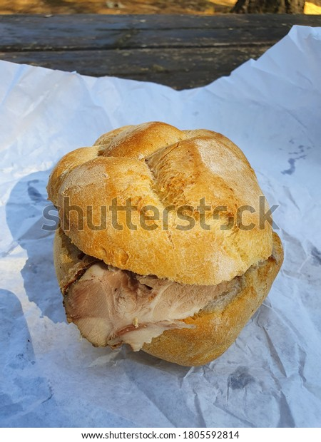 Panino con porchetta, typical italian street food with pork meat.