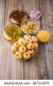 Panipuri or Gol Gappa or Chaat, Indian Street Food, Panipuri, Golgappe, Chat item, India, Stuffed Panipuri with aloo and Sweet Tamarind - Indian Food