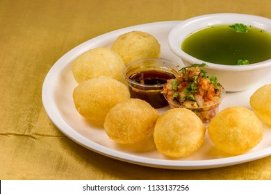 Panipuri or Golgappa is a common street snack from India. It's a round, hollow puri filled with a mixture of flavoured water and other chat items.