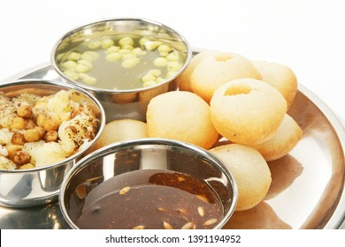 Panipuri or Golgappa  - Round hollow fried puri filled with flavored tamarind water