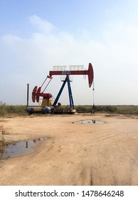 Panjin, Liaoning Province / China - September 23 2015: Pumpjack 'nodding donkeys' form part of the energy extraction business in north eastern China