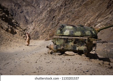 Panjshir Valley, Afghanistan, Mar 2004: Old Man and Russian tank at the entrance to the Panjshir Valley, Afghanistan