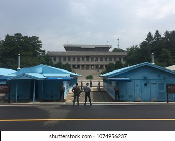Panmunjeom, DMZ, South Korea and North Korea Border Area - August 2 2017 : Two UNO South Korean soldiers facing up to the North Korean side of the Joint Security Area at the Korean border