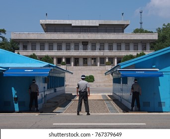 Panmunjeom, South Korea - June 14, 2014: Soldiers keep guard at the border between South Korea and North Korea. The DMZ - Demilitarized Zone - is one of the world's most tense borders.