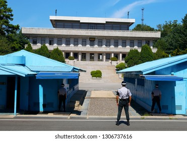PANMUNJOM, SOUTH KOREA - August 22, 2018: Korean soldiers watching border between South and North Korea in the Joint Security Area (DMZ) on august 22, 2018 in Panmunjom, South Korea.