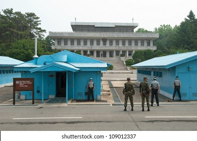 PANMUNJOM, SOUTH KOREA - CIRCA JUNE 2012: South Korean Soldiers in DMZ watching border between South and North Korea circa June 2012 in Panmunjom, South Korea.