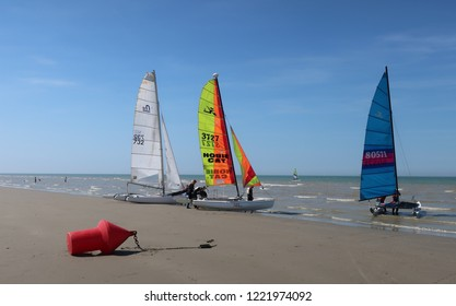 Panne, Belgium - August 6, 2018: Preparing the sailing boat catamarans at the beach on Belgian Northsea coast