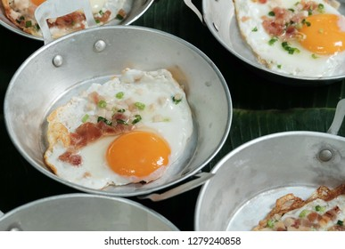 Panned egg with small pieces of grilled beef or pork bacon and top by sprinkle vegetables is popular menu for kids and family on holiday because it is easy to cook as quick breakfast and brunch
