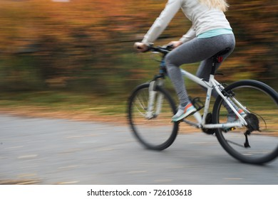Panning of riding a bike in autumn.