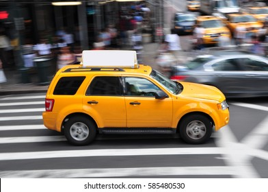 Panning shot of a taxicab at Times Square in New York, USA.