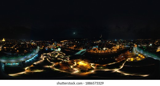 Panorama 360 of Tbilisi city with drone at night, Georgia