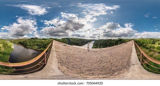 Panorama 360 view abandon bridge near river with nice cloudsfull. 360 by 180 degree seamless panorama in equirectangular spherical equidistant projection. Skybox for virtual VR AR reality content