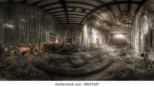 panorama of an abandoned theater with a destroyed ceiling, hdr processing