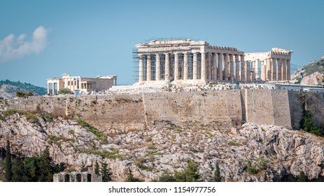 Panorama of Acropolis with Parthenon, Athens, Greece. Ancient Greek Parthenon is the main landmark of Athens. Scenery of the famous ruins in the Athens center in summer. Tourist postcard of Athens.