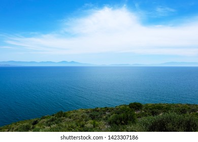 Panorama of the Aegean Sea. Beautiful top view of the Aegean Sea from a green hill on a bright sunny day. Kusadasi, Ozdere, 2019.