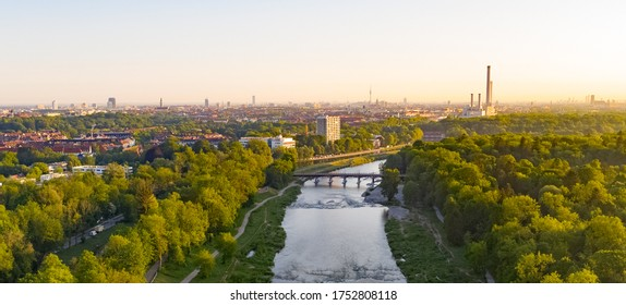 Panorama aerial bird view photograph of Isar river flowing into the south german city of Munich. Panoramic Munich centre behind river from above