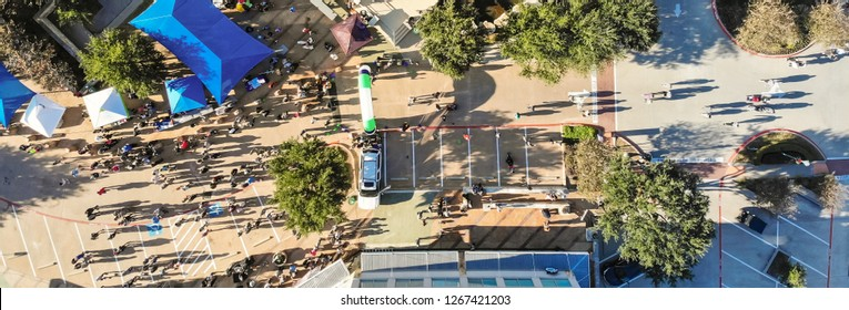Panorama aerial view 5K Turkey Trot family running event in Cedar Hills, Texas, USA. Straight down look of finish line with runners