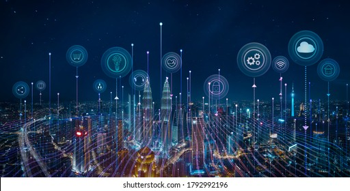 Panorama aerial view in the cityscape skyline with smart services and icons, internet of things, networks and augmented reality concept , night scene .