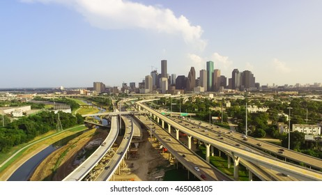 Panorama aerial view downtown and interstate I45 highway with massive intersection, stack interchange, road junction and elevated road construction at sunset from northwest side of Houston, Texas, USA