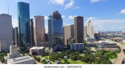 Panorama aerial view Houston downtown and Gulf Freeway (highway I45). Daytime cityscape with cloud blue sky.