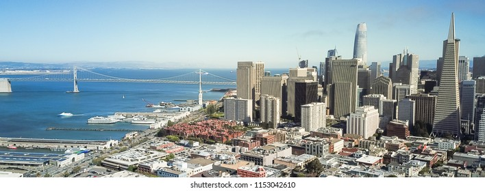 Panorama aerial view Jackson Square neighborhood with downtown skylines and Bay Bridge in background