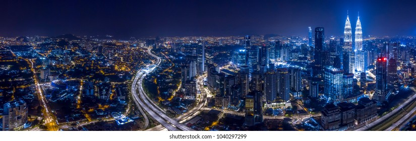 Panorama aerial view of Kuala Lumpur City center at night dusk.