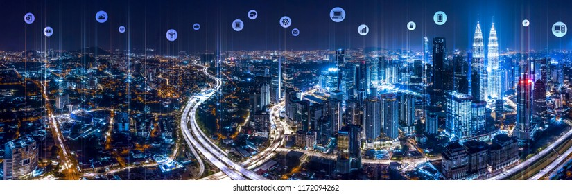 Panorama aerial view of Kuala Lumpur City center at night dusk with wireless communication network, abstract image visual, internet of things