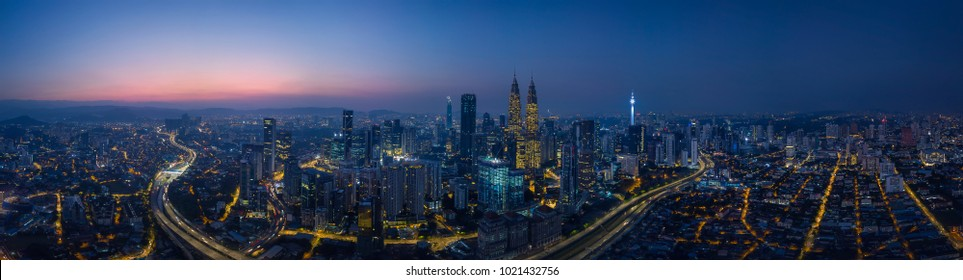 Panorama aerial view in the middle of Kuala Lumpur cityscape skyline .Night scene before sunrise , Malaysia .