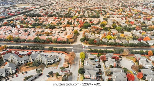 Panorama aerial view of  planned unit development in the Dallas, Texas suburb of Irving, Texas, USA. Colorful fall foliage leaves near row of single-family homes, urban sprawl subdivision