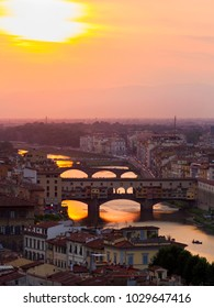 Panorama, aerial view, River Arno and Ponte Vecchio (Old Bridge), during the sunset, Florence, Tuscany, Italy.