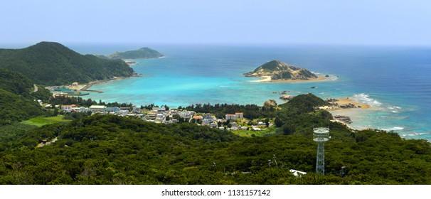 Panorama of Aharen Beach and beautiful turquoise waters home to coral reefs at Tokashiki Island in Okinawa, Japan