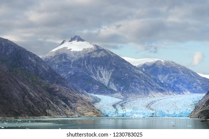 Panorama of an Alaskan Glacier and the Surrounding Mountains as it Meets the Sea
