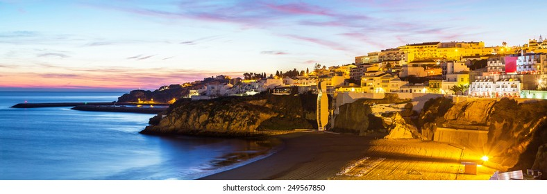 A panorama of Albufeira in the dusk in Algarve region, Portugal, Europe