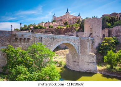 Panorama of the alcazar above the medieval San Martin bridge - Toledo, Spain