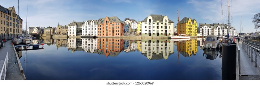 Panorama of the Alesund town reflected in the water, Norway
