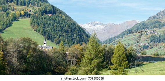 Panorama of the Alps mountains near the town of Rennweg am Katschberg with the power transmission line tower in the foreground . Carinthia, Austria.