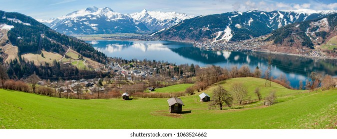 Panorama of Alps with Zell am See and lake Zeller. Spring panorama of  lake and Alps mountains in behind.