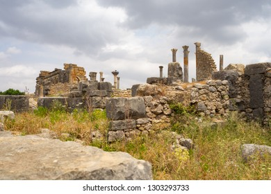 Panorama of the amazing ancient site of Volubilis, with the remains of the buildings of the Basilica and the Capitol. Volubilis, Morocco.
