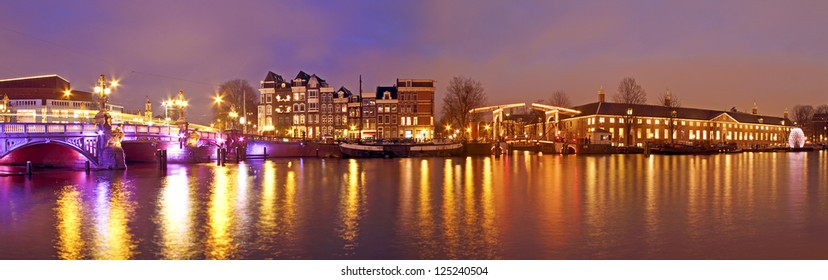 Panorama from Amsterdam innercity with the Amstel in the Netherlands by night